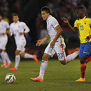 Bobby Shou Wood, USA, dribbles past Enner Valencia, Ecuador, during the USA Vs Ecuador International match at Rentschler Field, Hartford, Connecticut. USA. 10th October 2014. Photo Tim Clayton