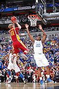 Doron Lamb #20 of the Kentucky Wildcats defends the basket against Scott Christopherson #11 of the Iowa State Cyclones during the third round of the NCAA men's basketball championship on March 17, 2012 at KFC Yum! Center in Louisville, Kentucky. Kentucky advanced with an 87-71 win. (Photo by Joe Robbins)