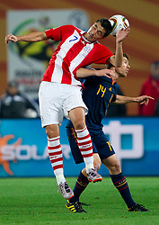 Oscar Cardozo of Paraguay vs Xabi Alonso of Spain during the  2010 FIFA World Cup South Africa Quarter Finals football match between Paraguay and Spain on July 03, 2010 at Ellis Park Stadium in Johannesburg. (Photo by Vid Ponikvar / Sportida)