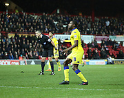 Leeds United attacker Mustapha Carayol and Referee Iain Williamson watching to see of ball went in during the Sky Bet Championship match between Brentford and Leeds United at Griffin Park, London, England on 26 January 2016. Photo by Matthew Redman.