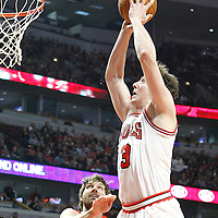 24 March 2012: Chicago Bulls center Omer Asik (3) goes for the dunk during the Chicago Bulls 102-101 victory in overtime over the Toronto Raptors at the United Center, Chicago, Illinois, USA.