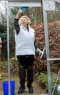 20-03-2015 Barneveld Princess Beatrix voluntering for NLDoet in the garden of the nursinghouse (verpleeghuis Norschoten) in Barneveld.<br /> NL Doet is a National Volunteer day organized by the Oranje Fonds. Prinses Beatrix, Prins Bernard, Prinses Annette, Prins Floris, Prinses Aim&eacute;e en<br /> de heer Tjalling Ten Cate hebben zich op vrijdagochtend ingezet in Barneveld, bij Stichting Christelijk Verpleeghuis Norschoten. Zij gingen aan de slag met het lenteklaar maken van de tuin en de terrassen, speelden koersbal met de ouderen en hielpen bij een fotoproject. COPYRIGHT ROBIN UTRECHT