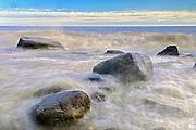 Waves crashing on rocks on shore of Lake Winnipeg<br /> Hecla Provincial Park<br /> Manitoba<br /> Canada
