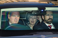 © Licensed to London News Pictures. 12/06/2017. London, UK. British prime minister THERESA MAY is seen smiling as she is driven from parliament in a car, following a 1922 Committee meeting.  Over the weekend British prime minister Theresa May formed a new cabinet and continues discussions with the DUP in an attempt to form a new government. Photo credit: Ben Cawthra/LNP