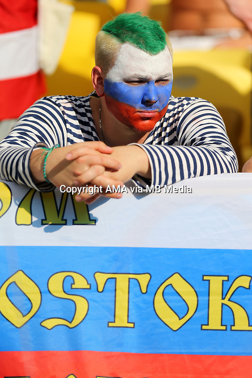 A dejected fan of Russia after losing 1-0 to Belgium
