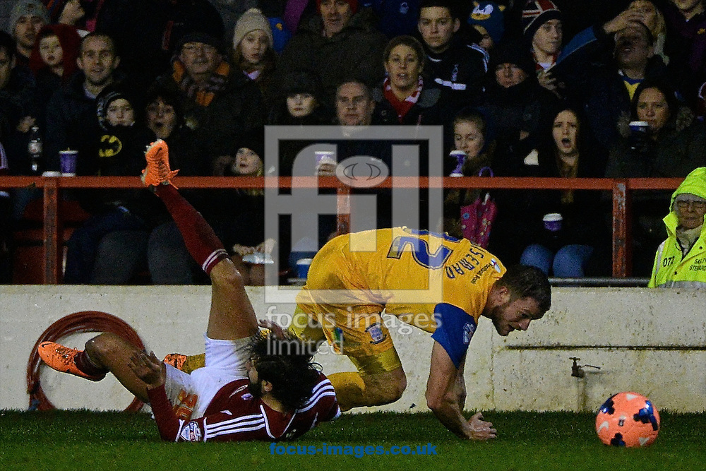 Picture by Ian Wadkins/Focus Images Ltd +44 7877 568959<br /> 24/01/2014<br /> Djamel Abdoun of Nottingham Forest is fouled by Scott Wiseman of Preston North End during the The FA Cup match at the City Ground, Nottingham.