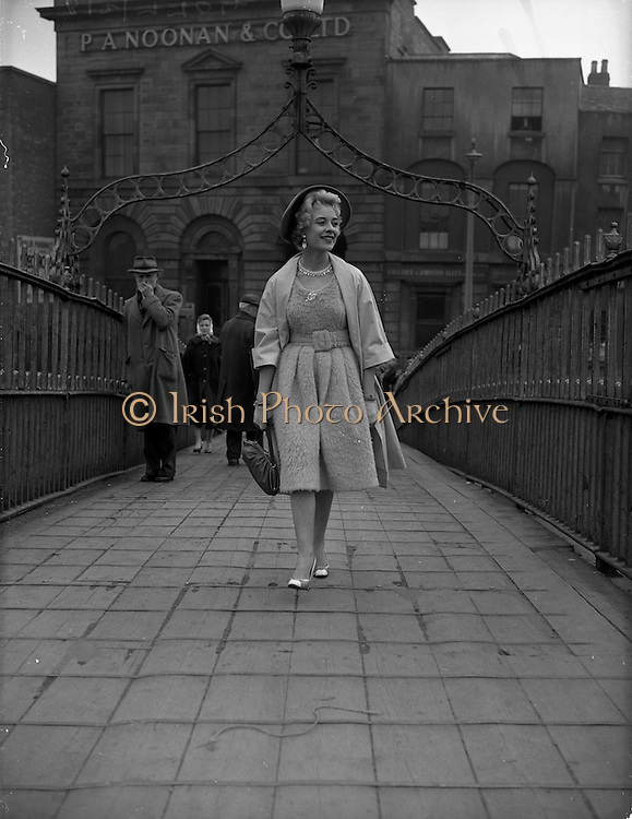 20/04/1959<br /> 04/20/1959<br /> 20 April 1959<br /> Miss May O'Callaghan an actress from  Kilburn, London on the Ha'penny Bridge in front of P.A. Noonan and Co., Dublin.
