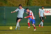 Lewes FC Stacy Freeman battles Dorking Wanderers James McShane during the Ryman League - Div One South match between Dorking Wanderers and Lewes FC at Westhumble Playing Fields, Dorking, United Kingdom on 28 January 2017. Photo by Jon Bromley.