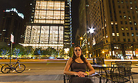 Flattering city lights in this night portrait in front of Comcast Building in Center City, Philadelphia.