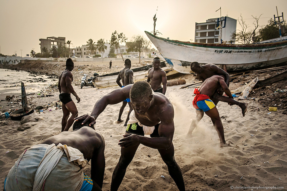 Young Wrestlers train traditional wrestling  during the evening hours at Boy Kaire's wrestling school on the beach of the Corniche of Dakar, March 31, 2015.
