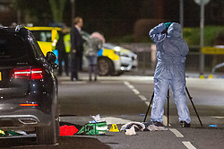 © Licensed to London News Pictures. 16/02/2020. London, UK. A forensic investigator gathers evidence next to medical equipment lon the ground at the scene of a multiple stabbing in Barking. Photo credit: Peter Manning/LNP