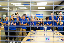 © Licensed to London News Pictures. 19/09/2014. Staff inside the Apple store cheer just before doors open ahead of the release of the iphone6 at the Apple Store in Chadstone Melbourne Australia. Australia is one of the first countries in the world to sell the iphone 6 due to geographic location & time zone. Photo credit : Asanka Brendon Ratnayake/LNP
