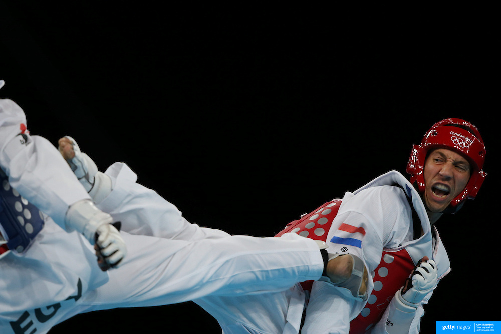Abdelrahman Ahmed, Egypt, (blue) in action against Tommy Mollet, The Netherlands, (red) during the Taekwondo Men 80kg competition during the London 2012 Olympic games. London, UK. 10th August 2012.