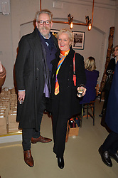 MICHAEL HOWELLS and KITTY ARDEN at the launch of the Private White VC flagship store, 73 Duke Street, London on 11th December 2014.