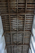 Timbered eaves with inscriptions and carved angels in the roof of Blythburgh church, Suffolk.