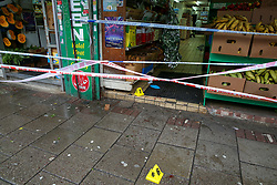 © Licensed to London News Pictures. 13/10/2019. London, UK. Evidence markers and blood stains at the entrance of West Green Halal Meat and Groceries store on West Green Road in Tottenham, North London where two men were stabbed and rushed to hospital shortly after 9.30am this morning. The ages of the two victim and their condition is not yet know. Photo credit: Dinendra Haria/LNP
