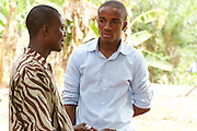 Calvin Doe (right), Youth Ambassador for The Kraft Cocoa Partnership talking to Daniel one of the teachers.