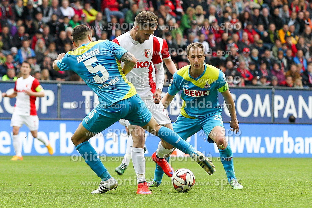 02.05.2015, SGL Arena, Augsburg, GER, 1. FBL, FC Augsburg vs 1. FC Koeln, 31. Runde, im Bild l-r: im Zweikampf, Aktion, mit Dominic Maroh #5 (1. FC Koeln), Tim Matavz #23 (FC Augsburg), Matthias Lehmann #33 (1. FC Koeln) // during the German Bundesliga 31th round match between FC Augsburg and 1. FC Cologne at the SGL Arena in Augsburg, Germany on 2015/05/02. EXPA Pictures &copy; 2015, PhotoCredit: EXPA/ Eibner-Pressefoto/ Kolbert<br /> <br /> *****ATTENTION - OUT of GER*****