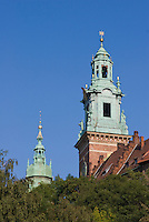 vertical shot of wawel cathedral towers against a bright blue sky with no clouds
