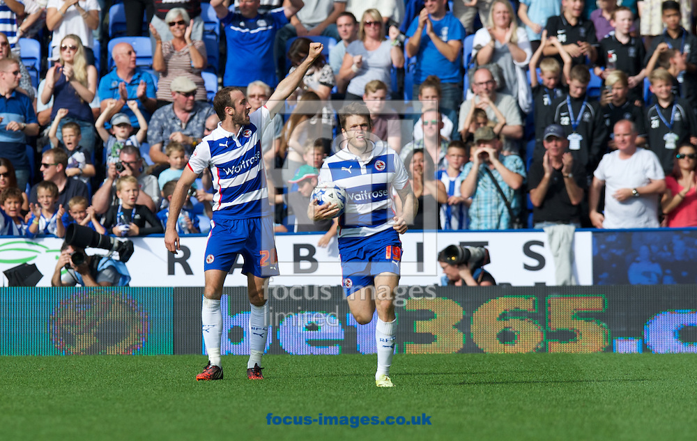Goalscorer Glenn Murray (20)of Reading  celebrates with the fans after scoring a late equaliser as Jamie Mackie returns with the ball during the Sky Bet Championship match at the Madejski Stadium, Reading<br /> Picture by Alan Stanford/Focus Images Ltd +44 7915 056117<br /> 28/09/2014
