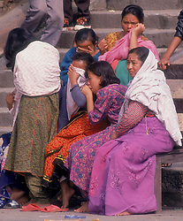KATHMANDU, NEPAL- Family members weep as their loved one is cremated at The Pashupatinath Temple, on the banks of the Baghmati River. This is the holiest Hindu Temple in Nepal. It is here that the faithful come to die and be cremated so that they may attain salvation.  (PHOTO © JOCK FISTICK)
