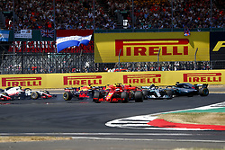 July 8, 2018 - Silverstone, Great Britain - Motorsports: FIA Formula One World Championship 2018, Grand Prix of Great Britain, ..Start, #5 Sebastian Vettel (GER, Scuderia Ferrari), #77 Valtteri Bottas (FIN, Mercedes AMG Petronas Motorsport), #44 Lewis Hamilton (GBR, Mercedes AMG Petronas Motorsport) (Credit Image: © Hoch Zwei via ZUMA Wire)