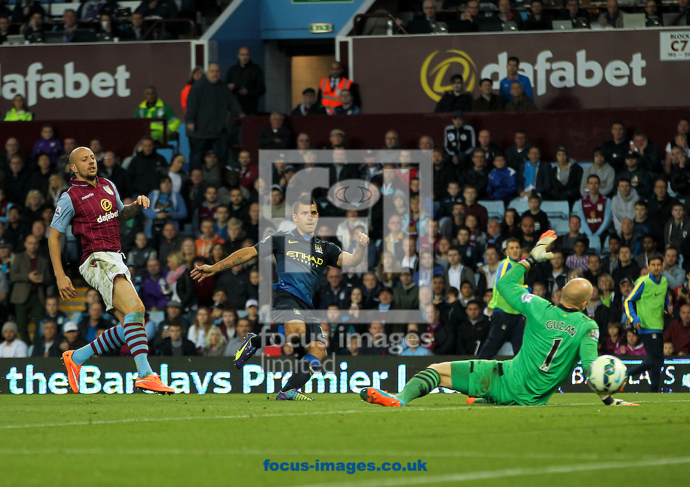 Sergio Ag&uuml;ero (centre) of Manchester City takes a shot at goal during the Barclays Premier League match at Villa Park, Birmingham<br /> Picture by Tom Smith/Focus Images Ltd 07545141164<br /> 04/10/2014