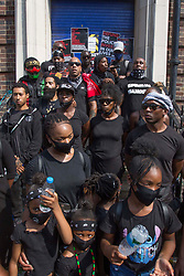 © Licensed to London News Pictures. 08/08/2020. London, UK. Members of Forever Family Force with its leader Khari McKenzie talk to Black Lives Matter protestors outside Tottenham Police Station in north London. Photo credit: Marcin Nowak/LNP