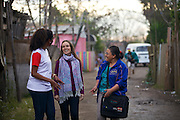 Marcia Cavalcanti (centre), director of  Cirandar, with C&A Instituto volunteer, Alyne Garcia Jobim, (right) approaching the site of a new  community library in Porte Alegre, Brazil.<br /> <br /> Cirandar is working alongside C&A and C&A Instituto to implement a network of Community Libraries in eight communities of Porto Alegre.