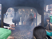 people putting incense smoke over there body Asakusa Kannon Temple Tokyo