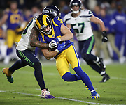 Los Angeles Rams wide receiver Cooper Kupp (18) gets tackled by Seattle Seahawks strong safety Bradley McDougald (30) during an NFL football game, Sunday, Dec. 8, 2019, in Los Angeles, Calif. The Rams defeated the Seahawks 28-12. (Peter Klein/Image of Sport)