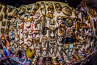 Handmade Venetian carnival masks on display at the shops of Ca' Macana, Venice, italy.