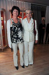 Left to right, BRIGID McCONVILLE and ANNIE LENNOX at a private dinner for the White Ribbon Alliance's Global Dinner Party Campaign, at Agua, Sanderson Hotel, Berners Street, London on 4th March 2010.