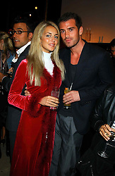 LADY ISABELLA HERVEY and MR SEAN MOORE at a party to celebrate the first 20 years of fashion label Donna Karan held at her store at 19/20 New Bond Street, London W1 on 21st September 2004.<br />