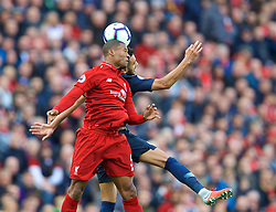 LIVERPOOL, ENGLAND - Sunday, October 7, 2018: Liverpool's Georginio Wijnaldum (L) challenges for a header with Manchester City's Riyad Mahrez during the FA Premier League match between Liverpool FC and Manchester City FC at Anfield. (Pic by David Rawcliffe/Propaganda)