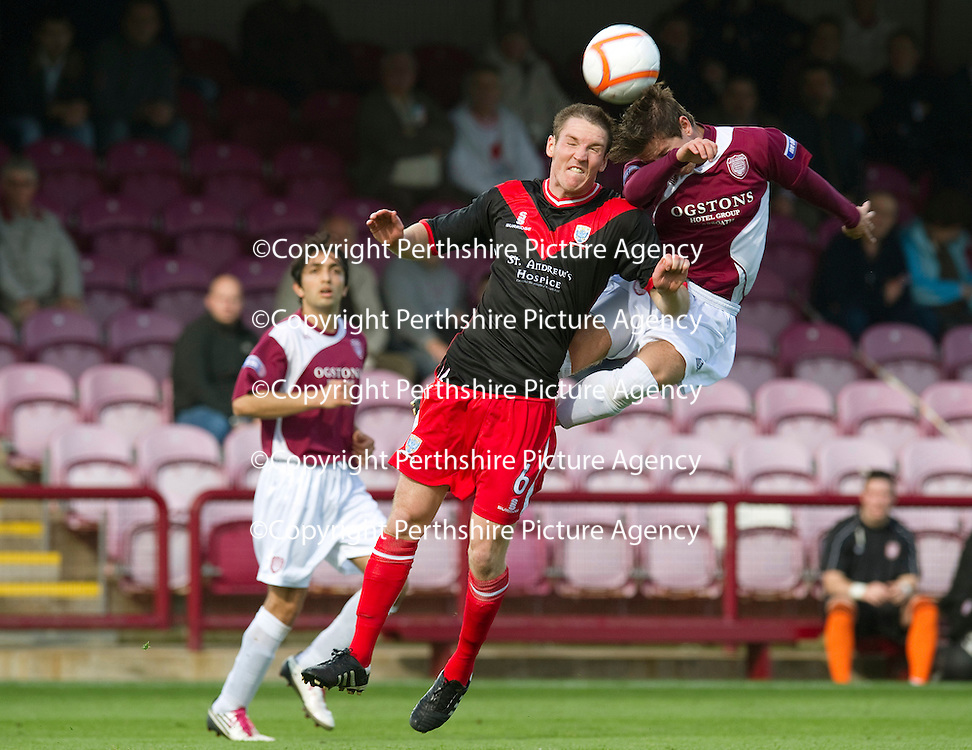 Arbroath v Airdrie Utd...17.09.11   <br /> Josh Falkingham gets up high to challenge Sean Lynch<br /> Picture by Graeme Hart.<br /> Copyright Perthshire Picture Agency<br /> Tel: 01738 623350  Mobile: 07990 594431
