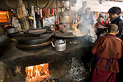 Monks and pilgrims prepare steaming butter tea at a small Buddhist monastery near the Jokhang, in Lhasa, Tibet. (From the book What I Eat: Around the World in 80 Diets.)