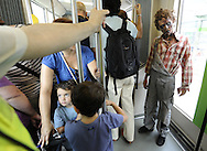 """Actors dressed up like zombies travel in tram, on September 2, 2010, in the Northern Spanish city of Bilbao. Actors and dancers, dressed up like zombies, visited Bilbao to promote the musical show """"Forever, King of Pop"""", based on Michael Jackson's """"Thriller"""".  PHOTO/Rafa Rivas"""