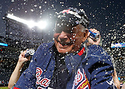 ATLANTA - OCTOBER 03:  Manager Bobby Cox #6 of the Atlanta Braves is doused by beer during the on-field playoff celebration after the game against the Philadelphia Phillies at Turner Field on October 3, 2010 in Atlanta, Georgia.  The Braves beat the Phillies 8-7.  (Photo by Mike Zarrilli/Getty Images)