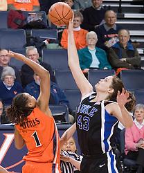 Duke University Blue Devils Center Alison Bales  (43) wins the opening tip over Virginia Cavaliers Forward Lyndra Littles (1).  The University of Virginia Cavaliers lost to the #1 ranked Duke University Blue Devils 76-61 at the John Paul Jones Arena in Charlottesville, VA on February 2, 2007.