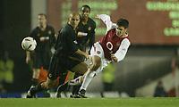 Fotball<br /> Carling Cup<br /> Arsenal v Wolverhampton 5-1<br /> 02.12.2003<br /> Francecs Fabregas - Arsenal<br /> Alex Rae - Wolves<br /> Foto: Anders Hoven, Digitalsport