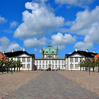 Cobblestone Path Entrance to Fredensborg Palace in Fredensborg, Denmark<br /> This long cobblestone pathway leading to the Fredensborg Palace is more than just an impressive approach.  Historically, the slot was built on the 300 acre &Oslash;strup farm as a hunting reserve.  Emulating from the royal building was a series of long shooting lanes. This configuration was called the hunting star or jagtstjeme.  This southern passage was originally constructed during the 1770s.