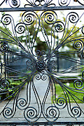 Decorative ironwork gate entry to the cemetery at St Michael's Church in historic Charleston, SC.