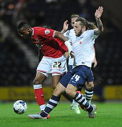 Jonathan Kodjia of Bristol City is tackled by Stevie May of Preston North End - Mandatory byline: Dougie Allward/JMP - 07966386802 - 15/09/2015 - FOOTBALL - Deepdale Stadium -Preston,England - Bristol City v Preston North End - Sky Bet Championship