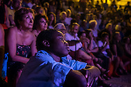 "People watching an event during ""Riace in festival2016"", a week festival where topics are culture, multiculturalism and migrations. RIACE (ITALY) 31/07/16"