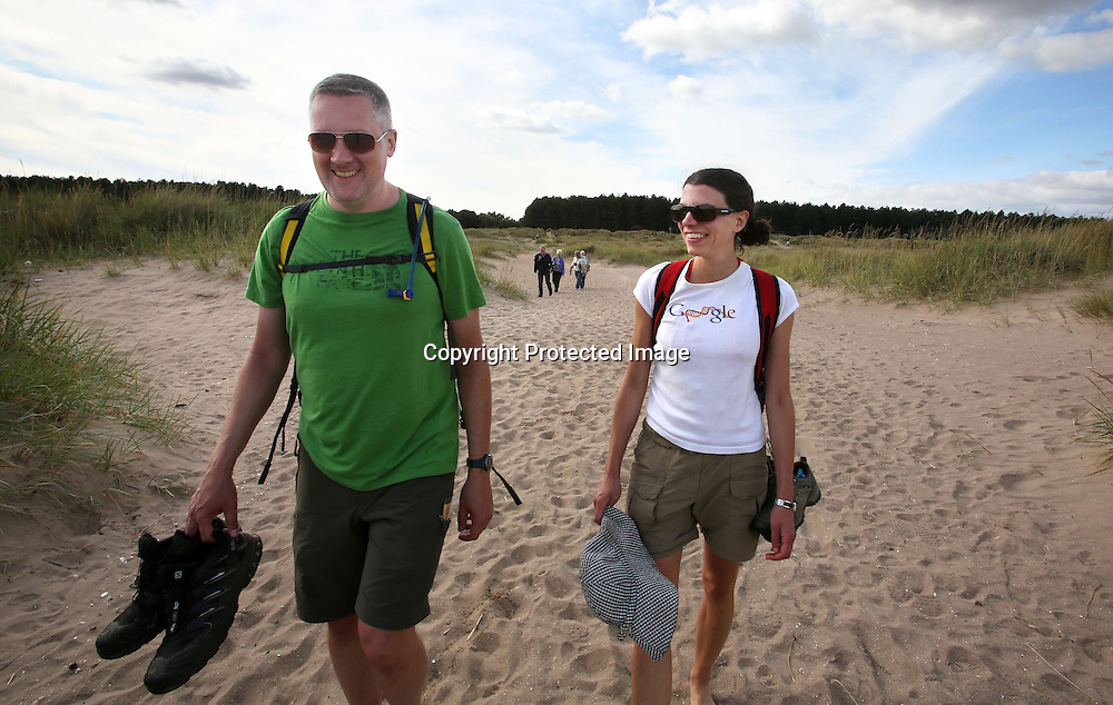 Walkers near the Tentsmuir forest Fife. 2015.Photograph David Cheskin