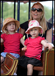 Autumn Phillips rides on the a fair rides with her children Isla and <br /> Savannah (left) at the Windsor Horse Show. Windsor, United Kingdom. Saturday, 17th May 2014. Picture by Andrew Parsons / i-Images