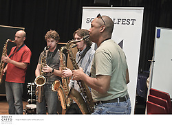 The Schoolfest programme in the New Zealand International Arts Festival gets kids and artists together to share, learn, and exchange ideas.  In this workshop, jazz superstar Branford Marsalis talks to students and the audience about his background, ideas about jazz, and plays with students at the NZ School of Music.