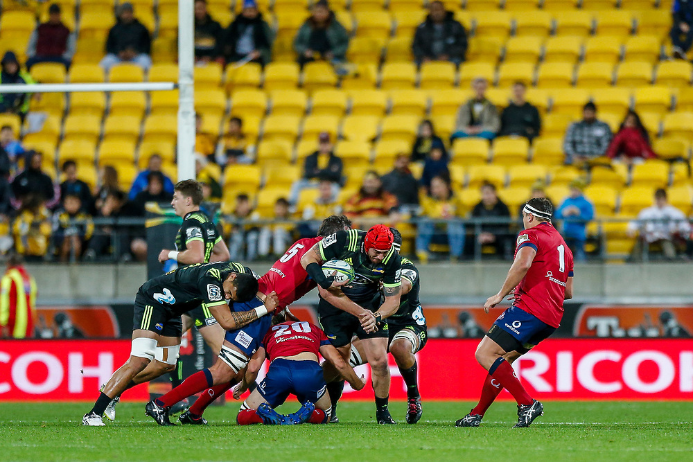Jeffery Toomaga-Allen tackled during the Super rugby union game (Round 14) played between Hurricanes v Reds, on 18 May 2018, at Westpac Stadium, Wellington, New  Zealand.    Hurricanes won 38-34.