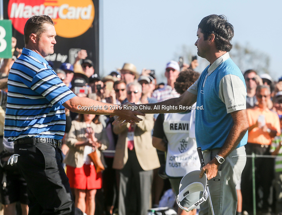 Bubba Watson, left, greeted by Jason Kokrak after winning on the final round of the PGA Tour Northern Trust Open golf tournament at Riviera Country Club on February 21, 2016, in Los Angeles. Bubba Watson won the Northern Trust Open.(Photo by Ringo Chiu/PHOTOFORMULA.com)<br /> <br /> Usage Notes: This content is intended for editorial use only. For other uses, additional clearances may be required.